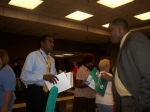 Chapter President Langston Willis (r) talks about NSU with the parent of a prospective student during the Eleanor Roosev