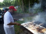 Clarence Mayfield mans the grill at the annual PGCMDC cookout.