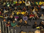 A sea of green and gold as Spartans watch the game.