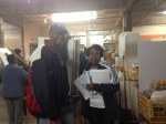 Langston Willis and Priscilla Lewis at the warehouse gathering supplies for the event.
